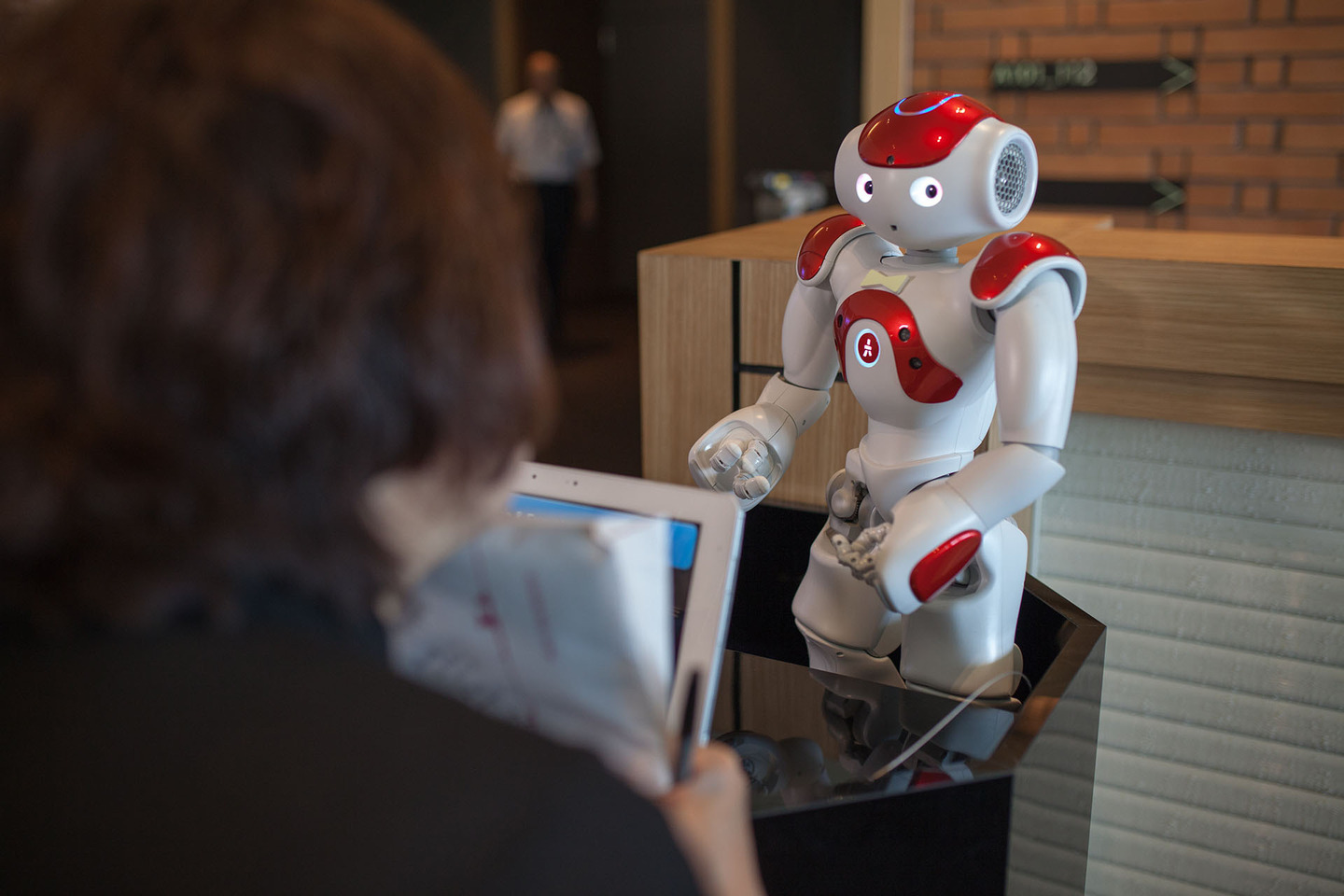 SASEBO, JAPAN - JULY 15: A robotic concierge handles guests questions at the Henna Hotel (Weird Hotel) in Huis Ten Bosch, Netherlands themed amusement park on July 15, 2015 in Sasebo, Japan. The Henna Hotel, scheduled to open on July 17, features multi-lingual humanoid robots that greet visitors while other robots serve coffee and do the cleaning, as well as room doors that are opened by face-recognition technology. (Photo by Trevor Williams/WireImage)