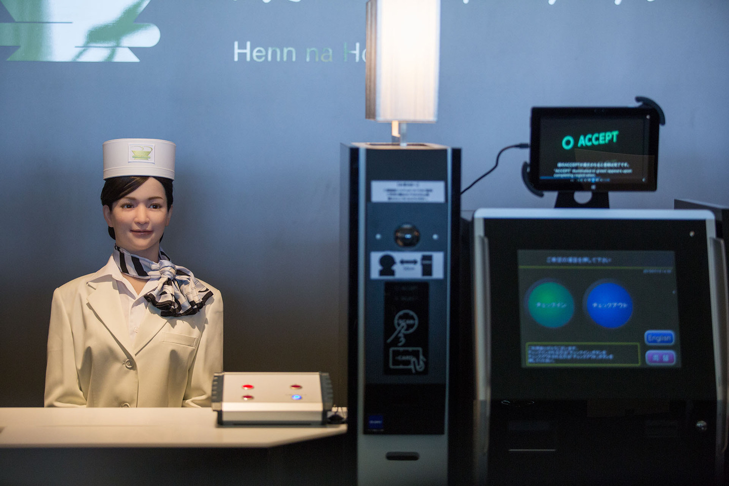 SASEBO, JAPAN - JULY 15: Guests check in via a completely automated system including a humanoid robot at the Henna Hotel (Weird Hotel) in Huis Ten Bosch, Netherlands themed amusement park on July 15, 2015 in Sasebo, Japan. The Henna Hotel, scheduled to open on July 17, features multi-lingual humanoid robots that greet visitors while other robots serve coffee and do the cleaning, as well as room doors that are opened by face-recognition technology. (Photo by Trevor Williams/WireImage)